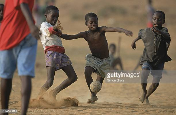 Youth Soccer Miscellaneous children in action playing in streets Monrovia Liberia 2/24/2001