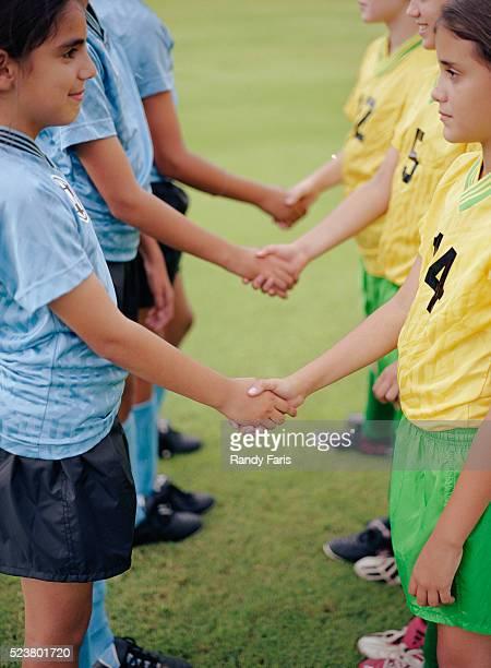 youth soccer teams shaking hands - respekt bildbanksfoton och bilder