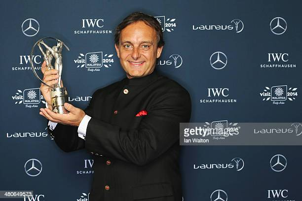 Youth Sport Educator Matthew Spacie winner of the Sport For Good award Magic Bus award poses with their trophy during the 2014 Laureus World Sports...