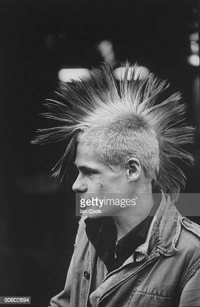 Youth standing in King's Road district wearing spiky Mohawk inspired punk hairstyle