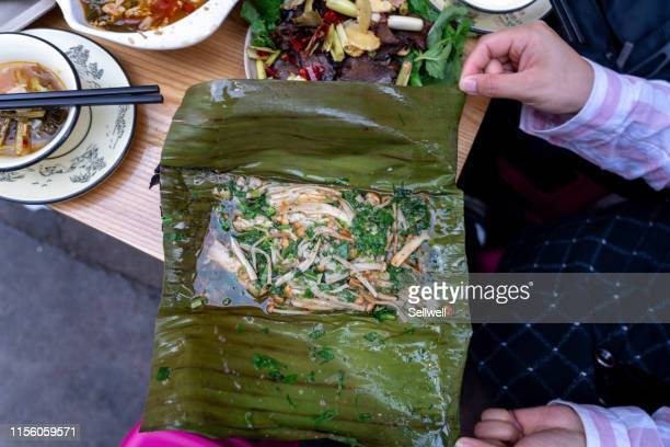 youth tasting yunnan traditional food in kunming - kunming stock pictures, royalty-free photos & images