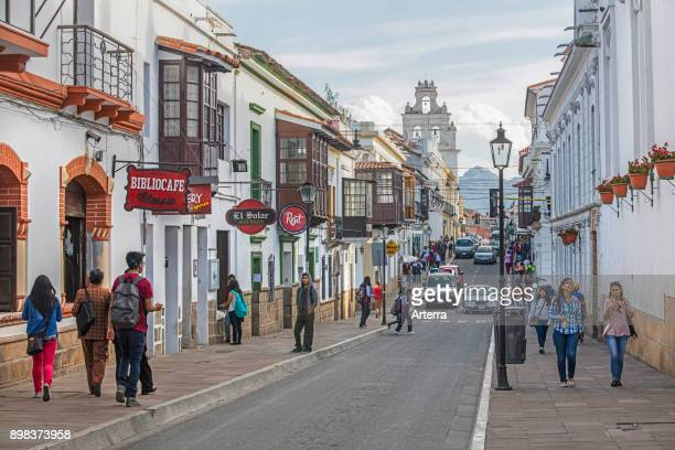 Youth walking in the colonial street in the white city of Sucre constitutional capital of Bolivia in the Oropeza Province
