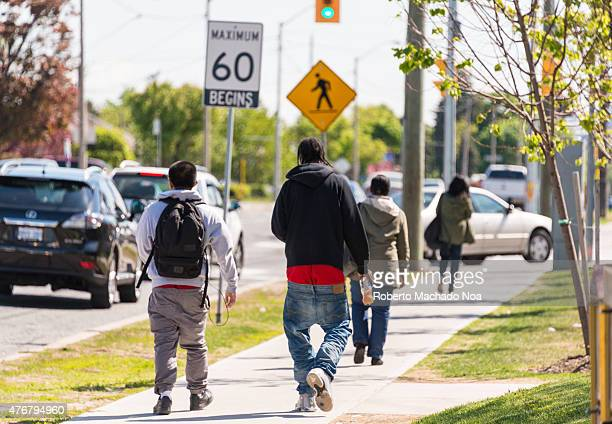 Youth walking on the street with low lowered pants Sagging is a manner of wearing trousers or jeans which sag so that the top of the trousers or...