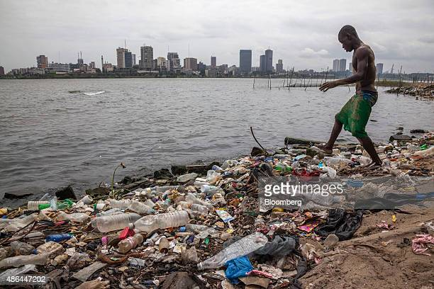 Youth walks across rubbish as he approaches the Ebrie lagoon for a swim in Abidjan, Ivory Coast, on Monday, Aug. 31, 2015. The stability from the...