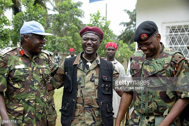 Youthful BrigadierGeneral Kai Farley Commander of the Movement for Democracy of Liberia discusses with LTGen Daniel Opande Commander of UNAMSIL and...