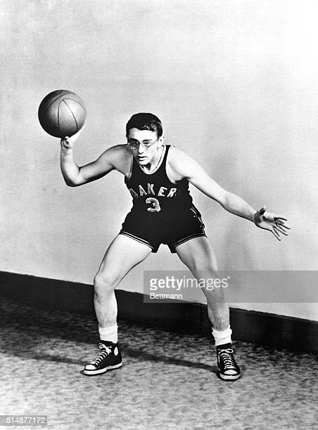 A youthful James Dean in gym shorts and sneakers prepares to pass a basketball Undated photgraph BPA2# 4761