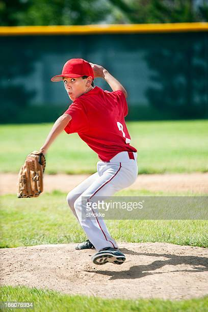 Youthful Male Baseball Pitcher Eyes Camera Winding Up on Moung