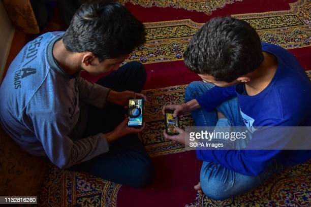 Youths are seen playing PUBG game on their mobile phones in Srinagar Kashmir PUBG the game which has the youth glued to their phone screens has...