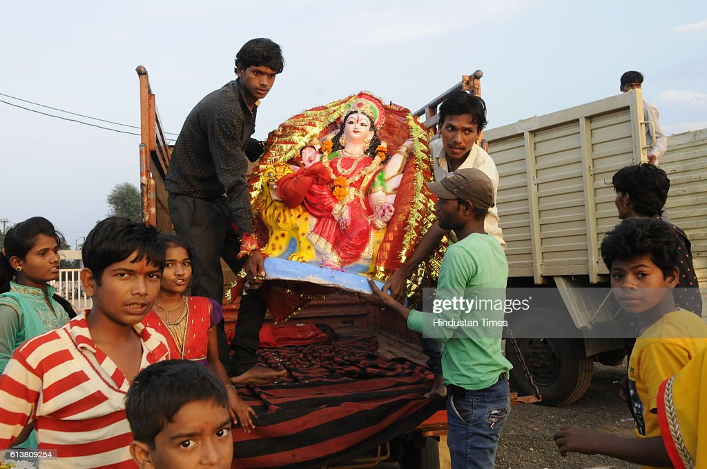 Youths carrying idol of Goddess Durga for immersion at Prempura Ghat on October 10, 2016 in Bhopal, India.