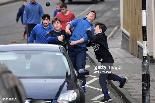 Youths chase after the leather ball during the annual 'Fastern Eve Handba' event in Jedburgh's High Street in the Scottish Borders on February 22...
