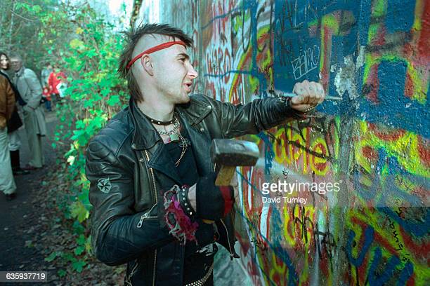 Youths Chipping Away at Berlin Wall