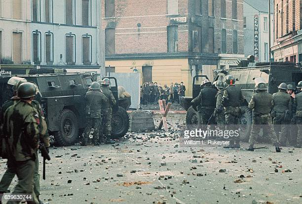 Youths confront British soldiers minutes before paratroopers opened fire killing 14 civilians on what became known as Bloody Sunday The standoff is...