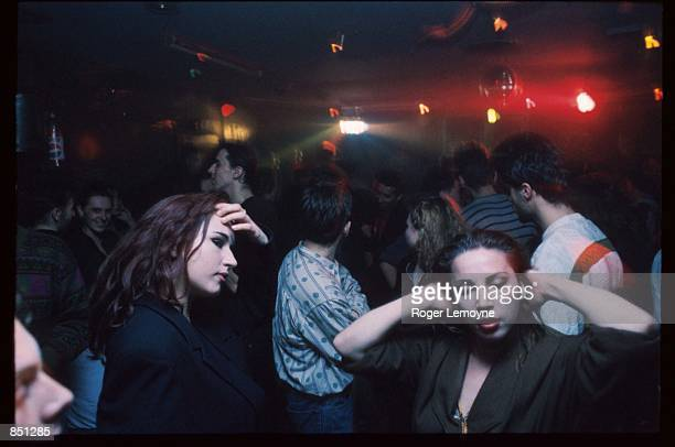 Youths dance in a club December 1, 1994 in Sarajevo, Bosnia-Herzegovina. When Bosnia declared its independence in March of 1992, the Bosnian Serbs...