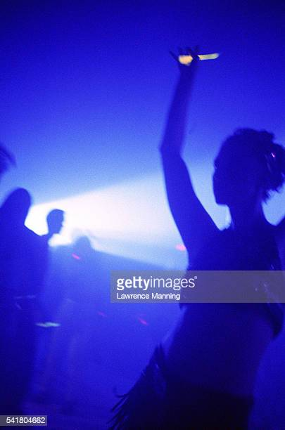 Youths Dancing at Rave Party