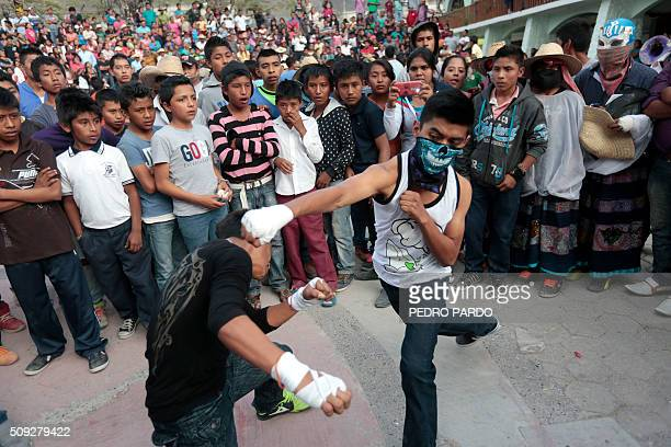 Youths engage in the traditional Xochimilcas fight to defend their women against the Aztecs in the Mexican municipality of Zitlala in Guerrero...
