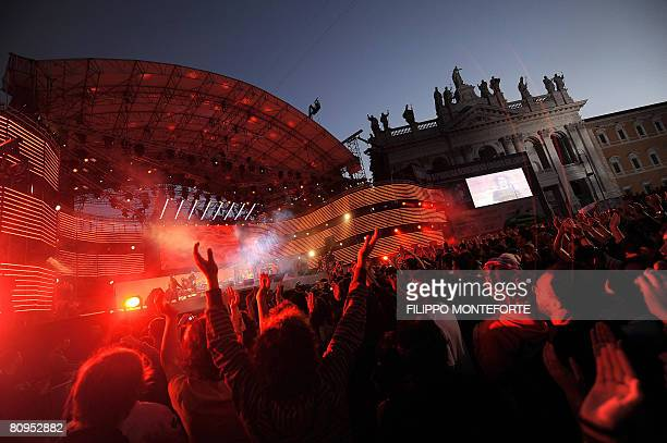 Youths enjoy the Mayday concert in front of Rome's St John Basilica on May 1 2008 Trade unions and politicians pushed this year to increase security...