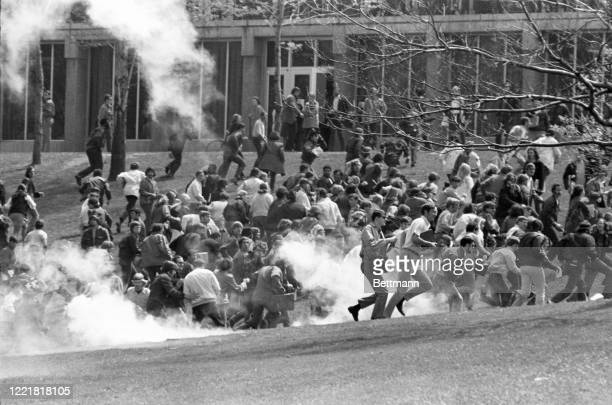 Youths flee as they try to escape exploding tear gar fired into their midst by National Guardsmen on the Kent State University campus.