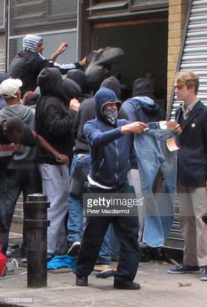 Youths loot a Carhartt store in Hackney on August 8 2011 in London England Pockets of rioting and looting continues to take place in various parts of...