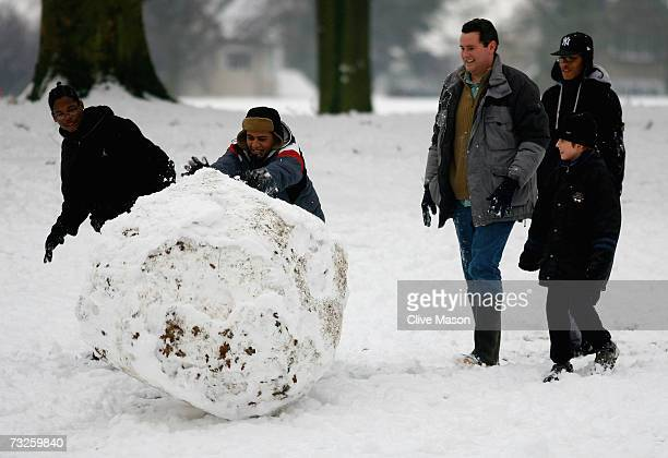 Youths make a giant snowball in Abington Park on February 8 in Northampton England snowfall across the UK has caused traffic chaos and schools to...