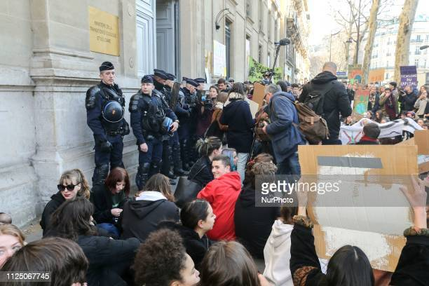 Youths mostly high school and college students demonstrate near the French Ministry for Ecology in Paris on February 15 2019 to protest against...