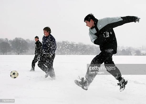 Youths playing football in Abington Park as heavy snowfall sweeps across the country on February 8 in Northampton United Kingdom