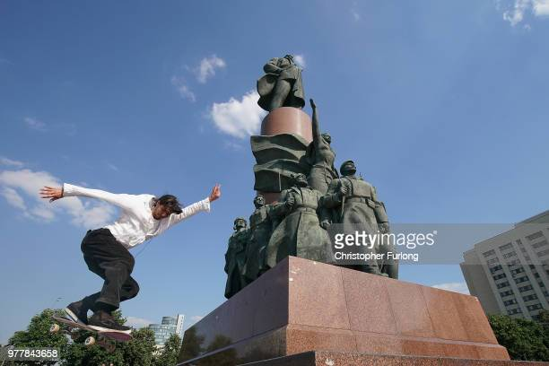 Youths practice their skateboard skills at the base of a Lenin statue on Kaluzhskaya Square on June 18 2018 in Moscow Russia