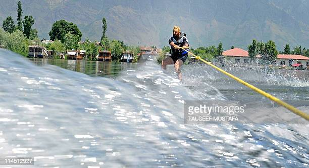 Youths receiving training from the Indian Institute of Skiing and Mountaineering water ski over Srinagar's Nageen Lake on May 23 2011 The Jammu and...