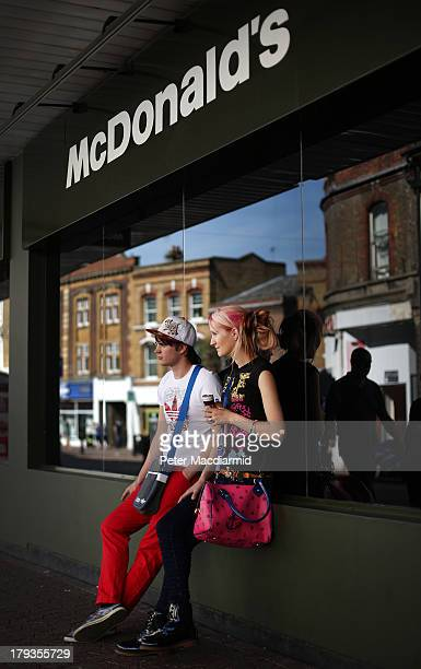 Youths sit outside a McDonald's in the High Street on September 2 2013 in Dartford England High Street campaigner Mary Portas is today facing...