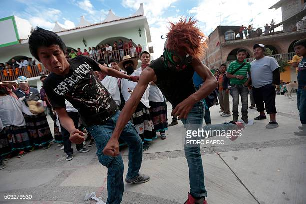 Youths take part in the traditional Xochimilcas fight to defend their women against the Aztecs in the Mexican municipality of Zitlala in Guerrero...