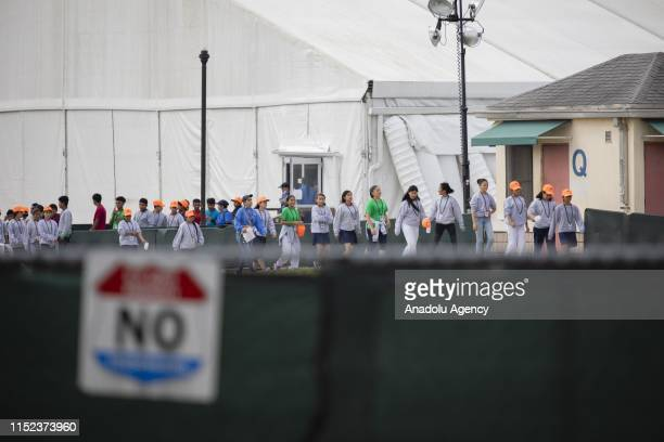 Youths walk inside the Homestead Temporary Shelter for Unaccompanied Children a detention facility for incarcerated youths that have been detained by...