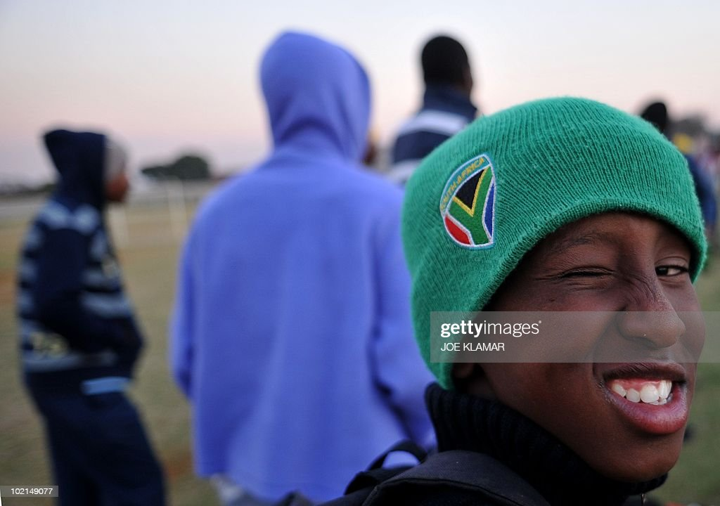 A youths watches a football match at Mamelodi township in Pretoria on June 16, 2010 during the 2010 World Cup football tournament in South Africa.