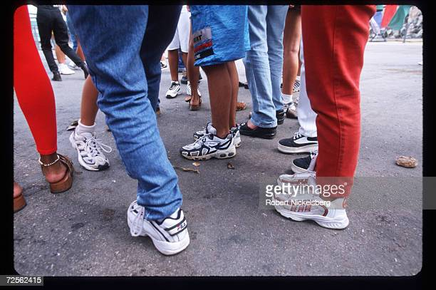 Youths wear Western sneakers sent by relatives from the US November 18 1999 in Havana Cuba The Cuban economy is on the verge of collapsing after the...