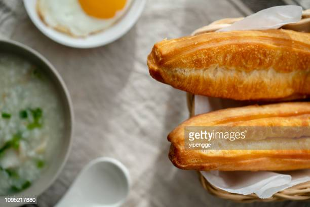 youtiao and  porridge - congee stock photos and pictures