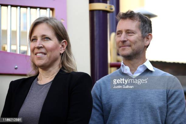 YouTube CEO Susan Wojcicki stands with her husband Dennis Troper during a press conference at Hamilton Families on November 21, 2019 in San...