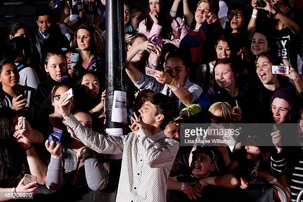 YouTube entertainer Troye Sivan takes photos with fans during the YouTube FanFest 2015 at Qantas Credit Union Arena on September 11 2015 in Sydney...