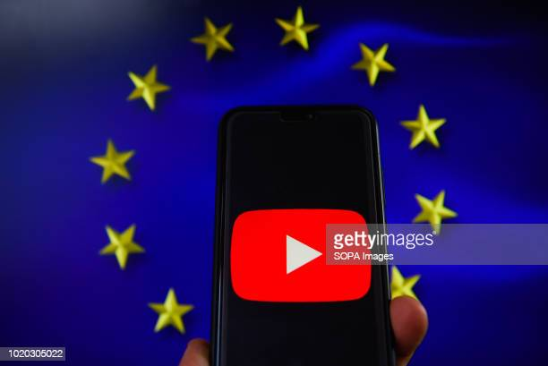Youtube logo with European Union flag are seen in this photo illustration The European Commission is planning issue a regulation that allows to fine...
