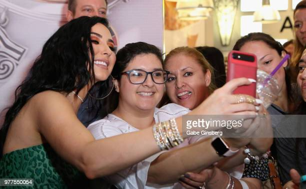 YouTube personality Jaclyn Hill takes selfies with fans during Morphe store opening at the Miracle Mile Shops at Planet Hollywood Resort Casino on...