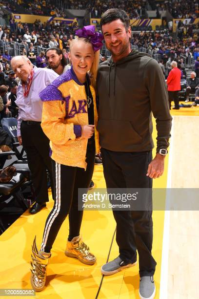Youtube personality JoJo Siwa poses for a photo with Pro Golfer Bubba Watson during the game between the Los Angeles Lakers and the Phoenix Suns on...