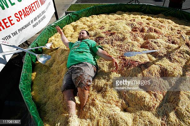 YouTube personality Shay Carl plays in a 15 foot 786pound bowl of spaghetti at the Italian eatery Buca di Beppo on March 12 2010 in Anaheim...