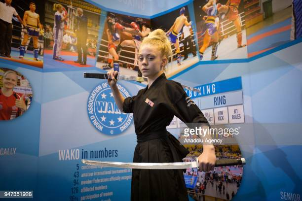 YouTube phenomenon JesseJane McParland poses at the World Association of Kickboxing Organisations stand during the third day of Sport Accord 2018 at...