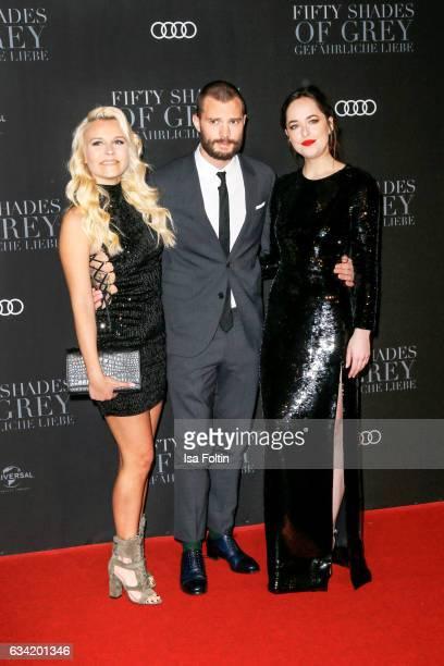 Youtube star Dagi Bee british actor Jamie Dornan and US actress Dakota Johnson attend the European premiere of 'Fifty Shades Darker' at Cinemaxx on...