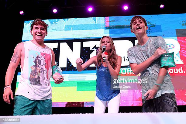 YouTube star Jc Caylen host Andrea Feczko and YouTube star Dylan Dauzat participate in Water War at Fullscreens INTOUR at Pasadena Convention Center...