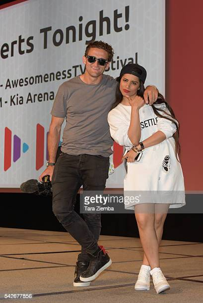 YouTube stars Casey Neistat and Lilly Singh pose for a photo at the 7th Annual VidCon at Anaheim Convention Center on June 22 2016 in Anaheim...