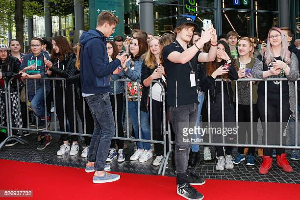 Youtube stars ConCrafter and iBlali with fans during the Berlin premiere of the film 'Angry Birds Der Film' at CineStar on May 1 2016 in Berlin...