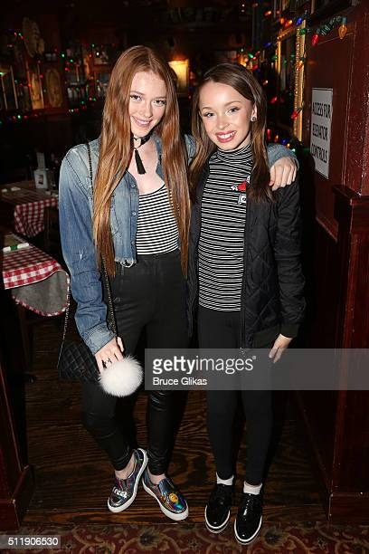 YouTube stars Larsen Thompson and Taylor Hatala of The Fraternal Twins pose at Buca di Beppo Times Square on February 23 2016 in New York City
