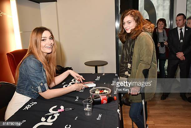 Youtuber Andy Raconte and a guest attend the Youtuber Andy Meets Her Fan At FNAC Bercy in Paris on April 2 2015 in Paris France