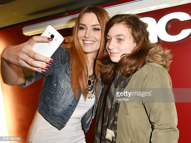 Youtuber Andy Raconte and a guest pose for a selfie during the Youtuber Andy Meets Her Fan At FNAC Bercy in Paris on April 2 2015 in Paris France