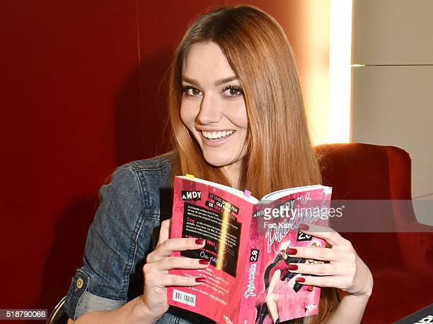 Youtuber Andy Raconte poses with her book during the Youtuber Andy Meets Her Fan At FNAC Bercy in Paris on April 2 2015 in Paris France