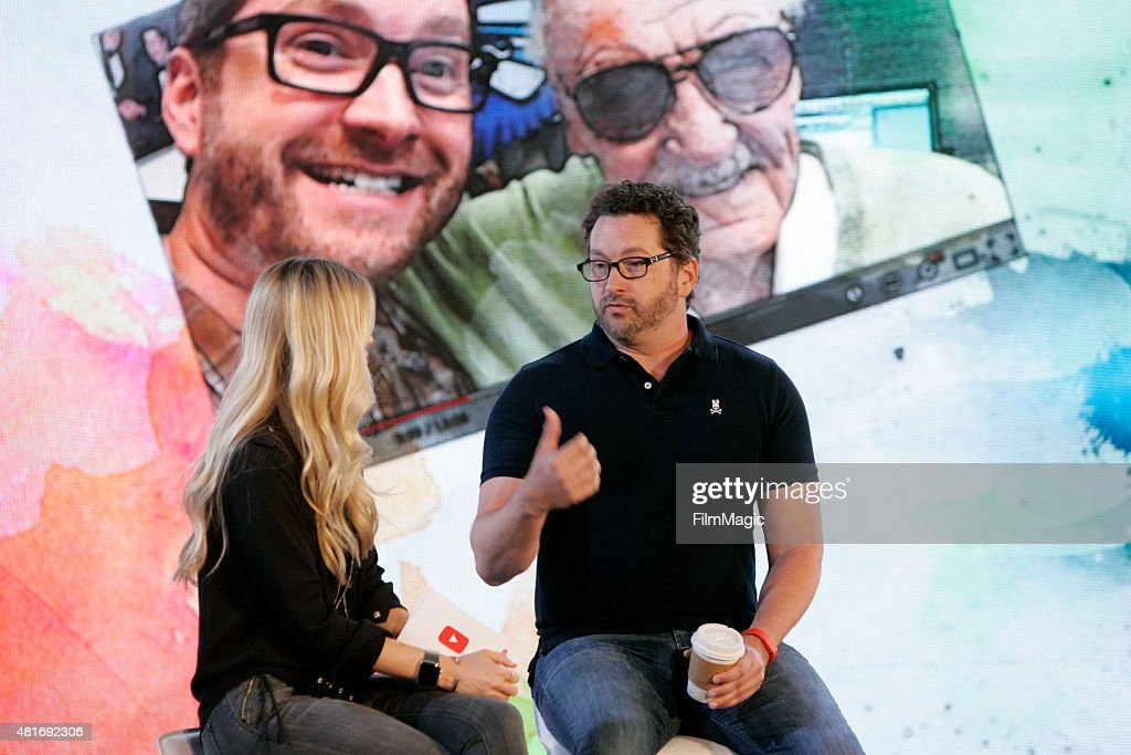 YouTuber iJustine (L) interviews YouTuber Burnie Burns of 'Rooster Teeth' at #BrandsAtVidCon at Anaheim Convention Center on July 23, 2015 in Anaheim, California.