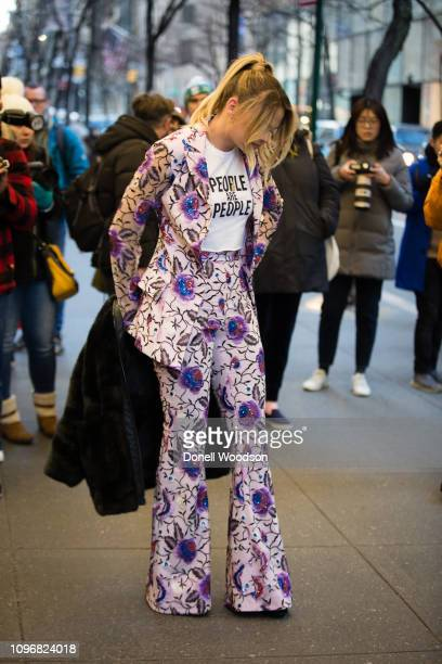 YouTuber Summer McKeen arrives outside of the Christian Siriano show during New York Fashion Week wearing a black coat floral blazer with matching...